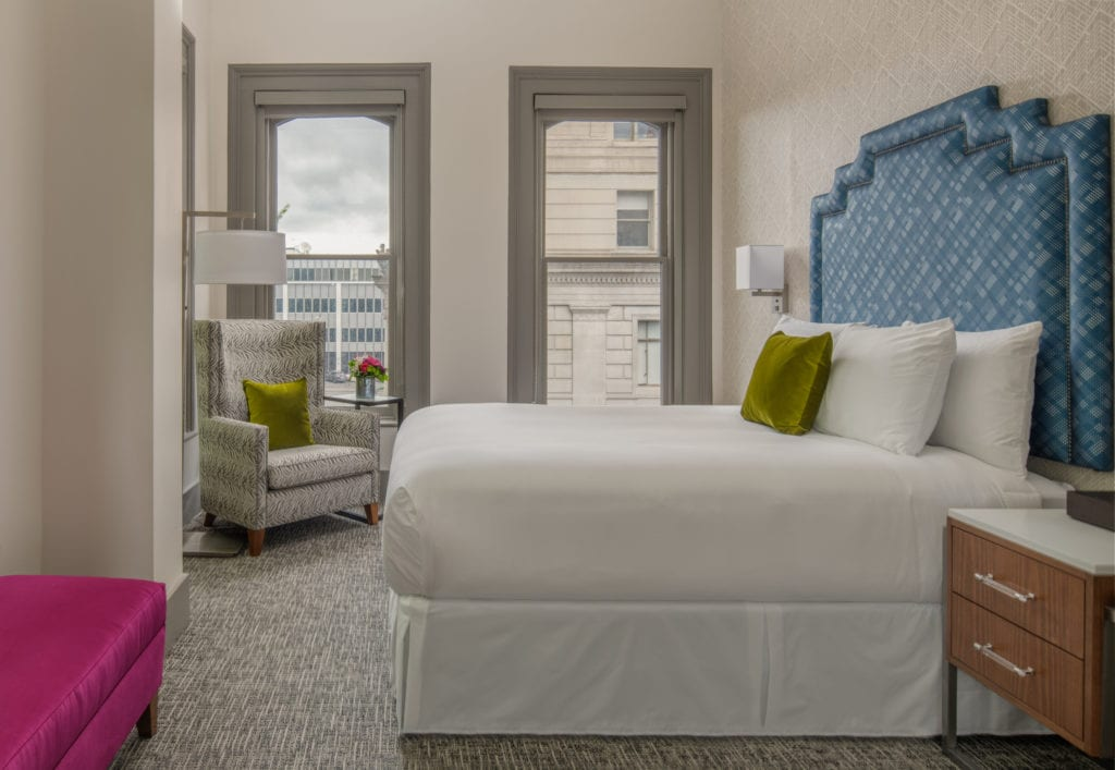 guestroom with chair and large windows